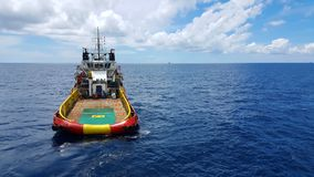 Supply boat for transferring cargo to oil and gas industry . Supply boat support oil and gas industry stock photography