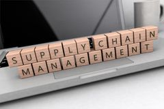 Supply Chain Management. Wooden letters on notebook computer - 3d render illustration Stock Photography
