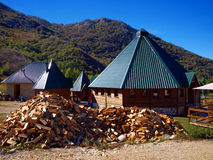 Supply of firewood in front of a mountain hut Stock Images