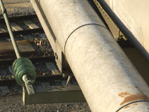 Supply lines. With toroidal expansion joint over railway tracks Stock Image