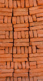 Supply of stacked orange bricks Stock Images