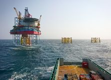 Supply vessel approaching offshore platform royalty free stock image