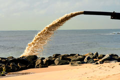Supplying sand Stock Image