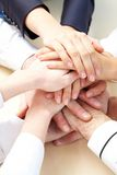 Support. Image of business people hands on top of each other symbolizing support and power Stock Images