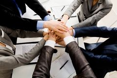 Support. Image of business people hands on top of each other symbolizing support and power royalty free stock image