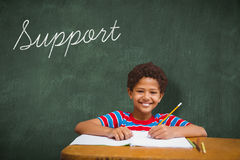 Support against green chalkboard Stock Photo