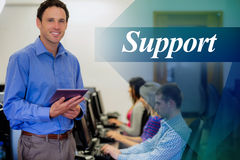 Support against teacher with students using computers in computer room Stock Photos