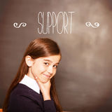 Support against thinking pupil looking at camera Stock Photography