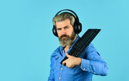 Support. call center and customer service help desk. gamer playing computer game. Digital Music Creation. bearded man