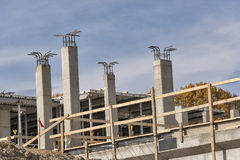 Support columns under construction on a construction site. Concrete support columns under construction on a construction site Royalty Free Stock Images