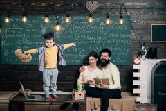 Support Concept. Kid Holds Teddy Bear And Performing. Boy Presenting His Knowledge To Mom And Dad. Parents Listening Royalty Free Stock Photos