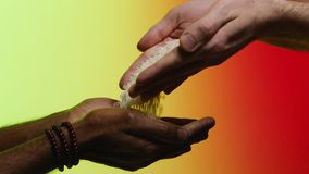 Support concept. Stock. Empathy, compassion, help, kindness. Humanitarian assistance to African countries. Hands pour. Rice into the hands of a black man stock footage