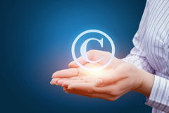 Support copyrights in the hands. Stock Images