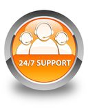 24/7 Support (customer care team icon) glossy orange round butto. 24/7 Support (customer care team icon) isolated on glossy orange round button abstract Royalty Free Stock Images