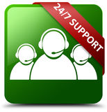 24/7 Support customer care team icon green square button. Reflecting shadow with red ribbon in corner Royalty Free Stock Photography