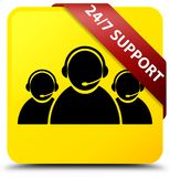 24/7 Support (customer care team icon) yellow square button red. 24/7 Support (customer care team icon) isolated on yellow square button with red ribbon in Stock Photo