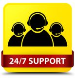 24/7 Support (customer care team icon) yellow square button red. 24/7 Support (customer care team icon) isolated on yellow square button with red ribbon in Stock Images