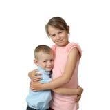 Support de garçon et de fille embrassé Image stock
