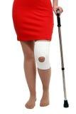 Support de genou avec la canne Image libre de droits