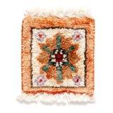 Support de tasse sous forme de tapis traditionnel Images stock
