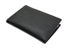 Support en cuir noir de passeport sous un angle Photos stock