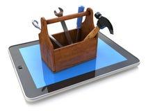 Support en ligne Boîte à outils avec des outils sur le PC de comprimé 3d Photographie stock