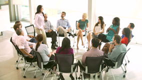 Support Group Meeting With People Seated In Circle Of Chairs Royalty Free Stock Photos