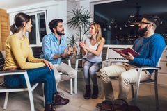 Support group meeting for people struggling with addiction. In home office stock images