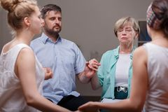 Support group during therapy. Support group sitting in a circle during therapy royalty free stock photo