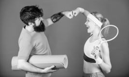 Support of Happy woman and bearded man workout in gym. Strong muscles and body. Sport equipment. Sporty couple training royalty free stock photos