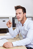 Support hotline call-agent in call. Support hotline call-agent working in call center with headset Royalty Free Stock Photos