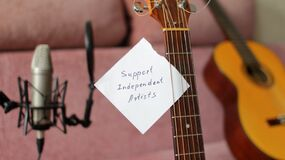 Support Independent Artists Note Attached to Guitar Strings in Home Studio of Indie Musician