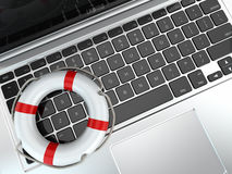Support. Laptop and life preserver for first help. Stock Photo