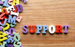 Support   letters      wood Stock Photos