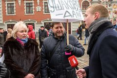 `Support` meeting, expressing support for Nils Usakovs, Mayor of Riga city council stock photos