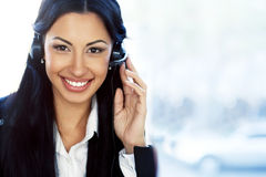 Support operator with headset and smiling Stock Photo