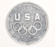 Support our teams. Silver coin for the American Olympic team Royalty Free Stock Photo