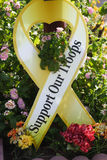 Support Our Troops. Yellow ribbon with flowers Stock Images