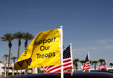 Support Our Troops. A motorcade of cars display the American flag, with one asking citizens to support our troops in Iraq stock photos