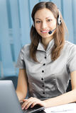 Support phone operator. In headset at workplace Stock Photos