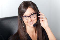 Support phone operator in headset at workplace Stock Photography