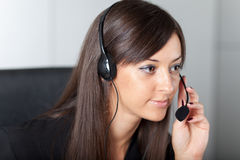 Support phone operator in headset at workplace Royalty Free Stock Image