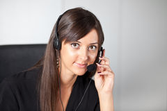Support phone operator in headset at workplace Royalty Free Stock Photos