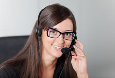 Support phone operator in headset at workplace Royalty Free Stock Photography