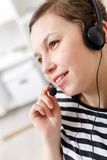 Support phone operator in headset at workplace Stock Images