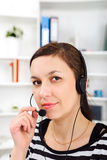 Support phone operator in headset at workplace Stock Image