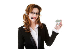 Support phone operator showing house model. Royalty Free Stock Image