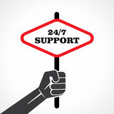 24/7 support placard holding hand.  Stock Photography