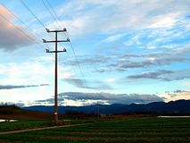 Support of power lines in the evening royalty free stock photo