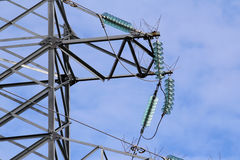 Support power lines with wires and insulators on a blue sky. royalty free stock photos